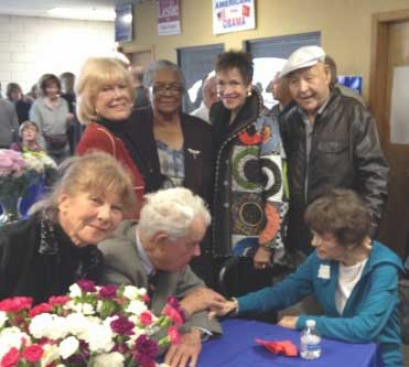 BI-PARTISAN SUPPORT — More than 100 people came to honor former Assemblywoman Vivian Freeman's legacy at WashoeDEMS headquarters on January 18, including (standing from left) longtime activist and celebration co-chair Mylan Hawkins, former State Sen. Bernice Mathews, D-Reno, top gun attorney Margo Piscevich, and former Washoe County Assessor and Truckee Meadows Democratic Alliance Chairman Bob McGowan, D. Seated (l to r) artist Renate Neumann, top gun attorney Peter Chase Neumann and former Nevada Lt. Governor Sue Wagner, R.